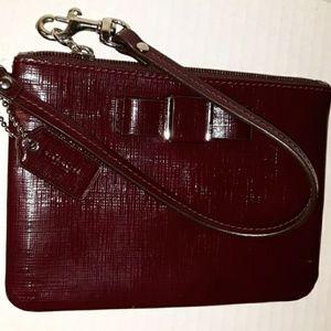 Coach Bags - EUC COACH crossgrain leather Darcy Bow Wristlet